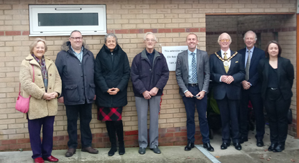 Councillors and others in front of building