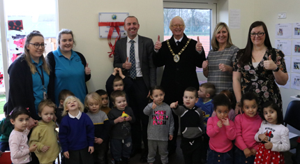 Councillors, nursery staff and children gathered together for photo