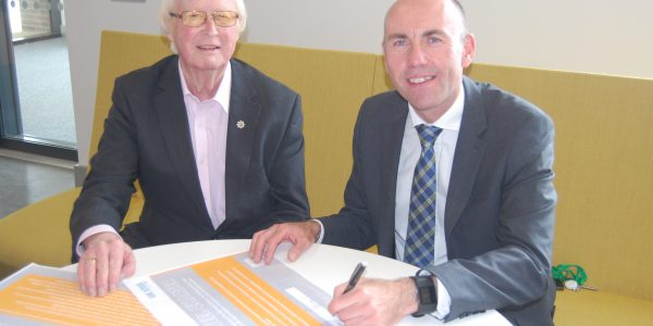 Cllr Rob Waltham and Cllr John Briggs signing the pledge