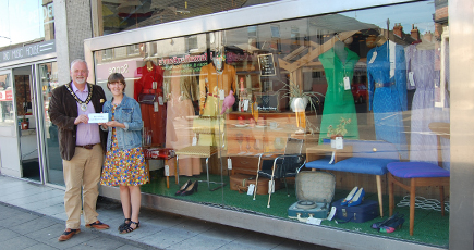 The Mayor of North Lincolnshire meets with vintage retailer, Hayley McPhun, at her Pride shop window display in Scunthorpe