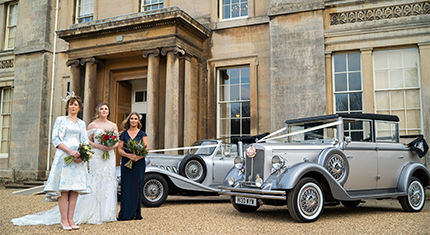 Outside Normanby Hall with wedding cars and 3 brides