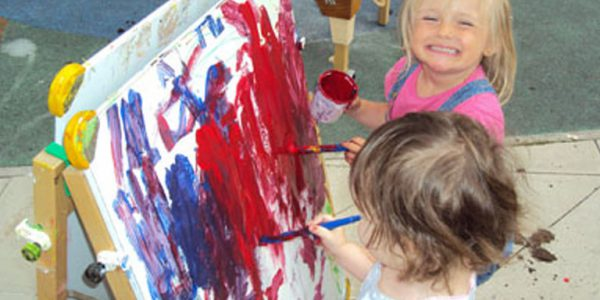 Two toddlers painting