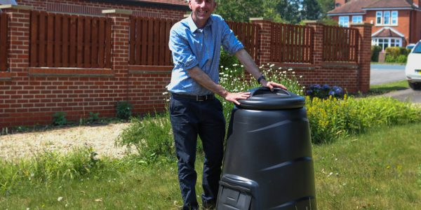 Cllr Waltham stood with his composter