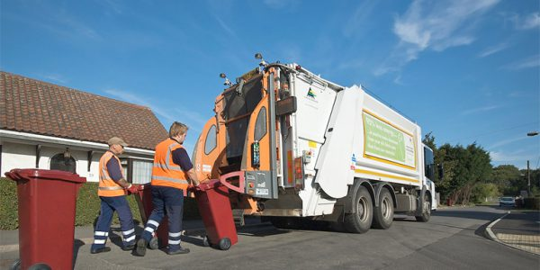 Refuse collectors collecting waste