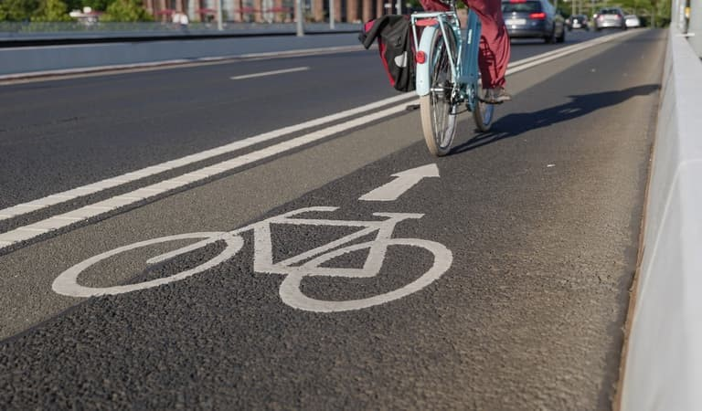 Close up of a cycle lane with a cyclist on a bike