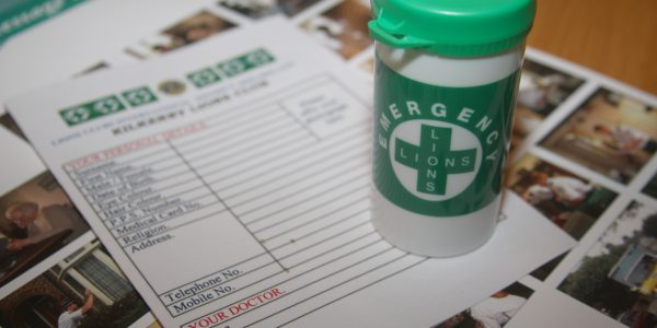 Message in a bottle emergency container with associated paperwork