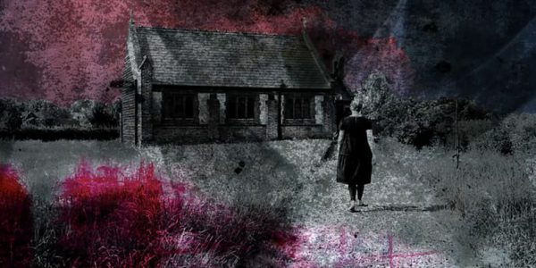 Lady dressed in black walking towards an old church