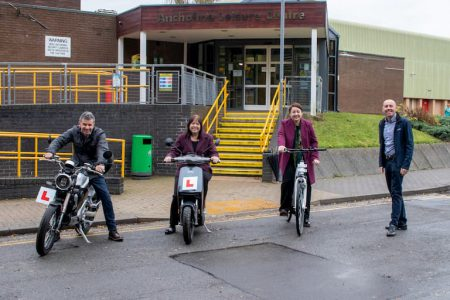 Four people on bikes and scooters outside Ancholme Leisure Centre, Brigg