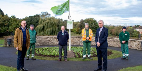 Green Flag in KIngsway Gardens, Scunthjorpe. with councillors and park staff