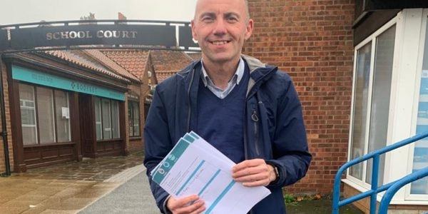 Photograph of Cllr Rob Waltham with a copy of the Personal Covid-Secure Plan
