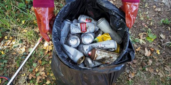 Discarded tin cans in a bin bag