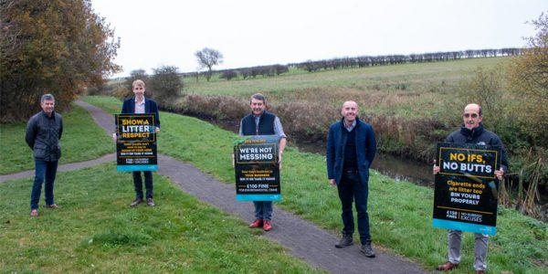 Photograph of councillors with litter signage on Bottesford Beck