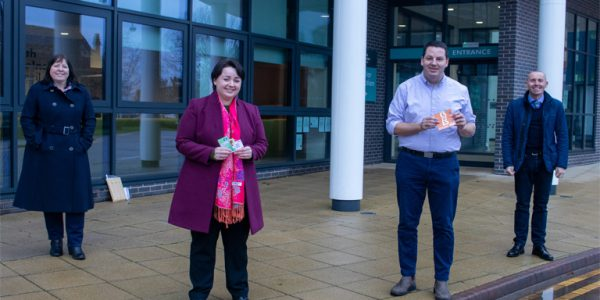 Photograph of local MPs, Leader of North Lincolnshire Council, Cllr Rob Waltham and cabinet member for children and families, Cllr Julie Reed, pictured with vouchers