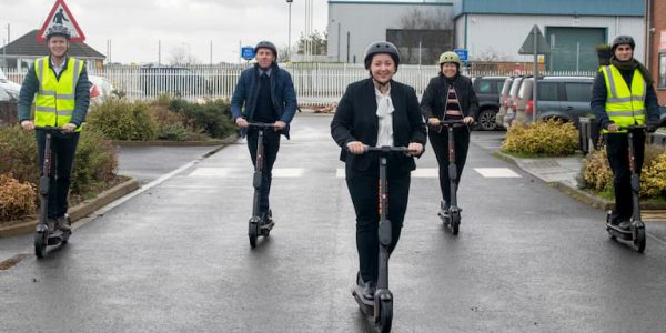 Five people ride electric scooters in a Scunthorpe car park