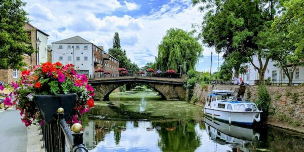 River Ancholme in Brigg with red flowers in planters