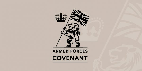Graphic of a lion holding a Union Jack with words Armed Forces Covenant