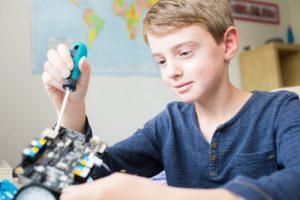 boy creating a model