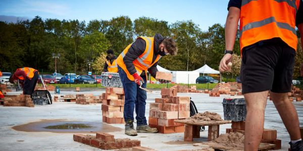 Bricklayers working with masks and socially distanced