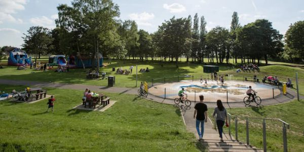 Families enjoying fine weather in Central Park Scunthorpe