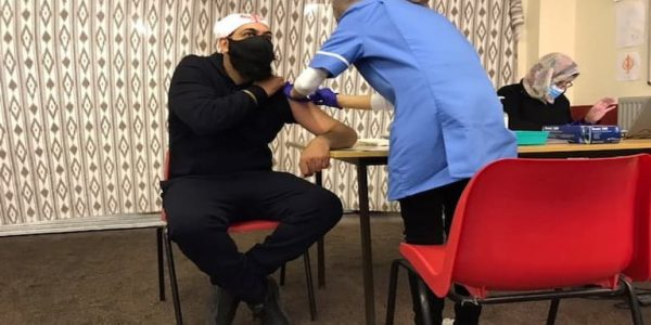 Individual from the Sikh community receiving their covid vaccine at Guru Nanak Gurudwara in Scunthorpe.