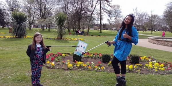 Tilly and Zaynah (Young Mayor) in Central Park holding Tilly's Don't litter poster with a litter picker