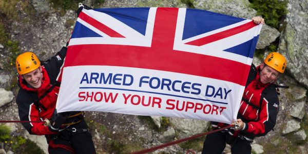 Mountain climbers holding an Armed Forces Day union jack
