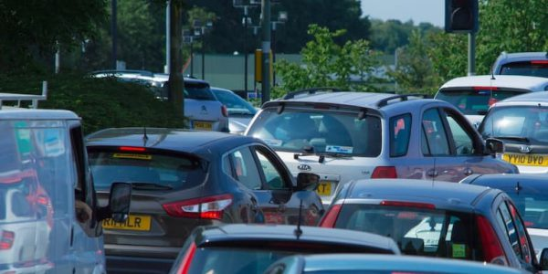 Lanes of cars queuing at red light