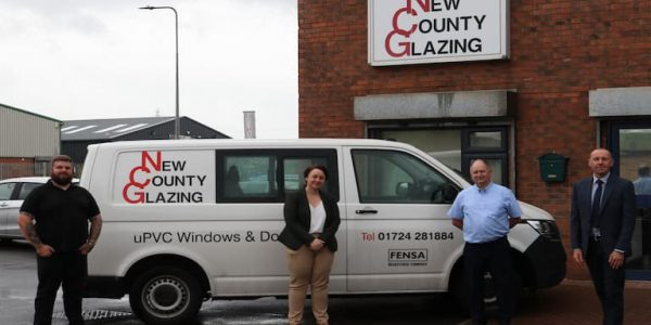 Picture of the outside of New County glazing featuring from left to right - John Carolan Junior, Scunthorpe MP Holly Mumby-Croft, John Carolan Senior and Cllr Waltham