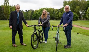 Photograph of John Marshall, CEO of R-evolution and Cllr Carl Sherwood, pictured with Rebecca Hollis, who donated a bicycle at Normanby Hall Golf Course
