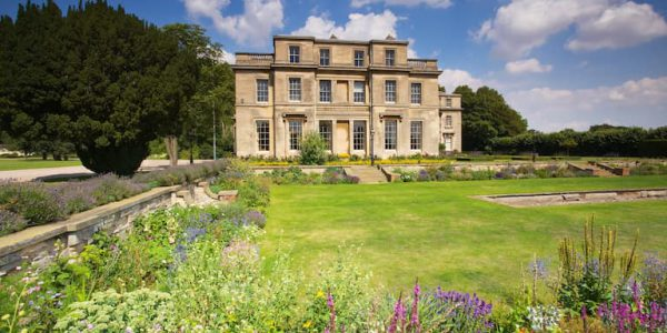 Photo of Normanby Hall with lawns and flower borders