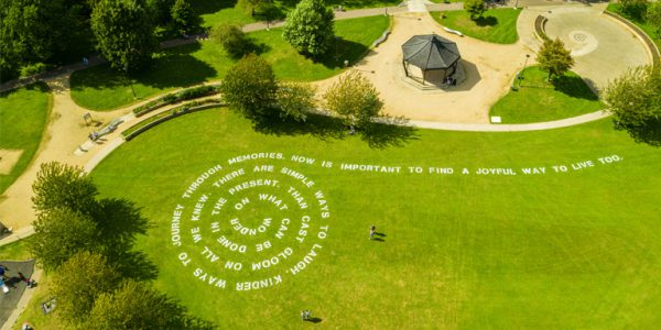 Photograph of a poem in a spiral shape in Gloucester Park. Image by FluxxFilms