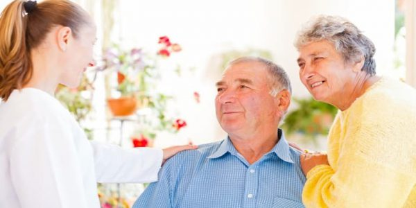 Elderly couple receiving advice and support