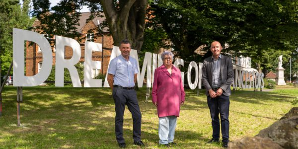Photograph of Cllrs Rob Waltham and John Davison, pictured with Ann Liles, author of the 'Dreaming with the Ancestors' poem