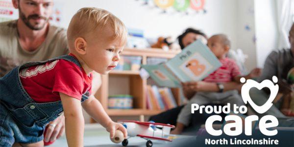 Photograph of a boy crawling in a nursery
