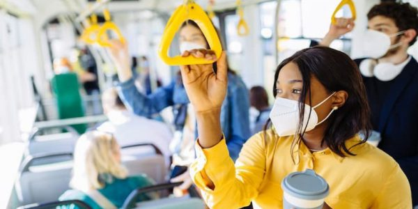 People wearing masks travelling on a bus