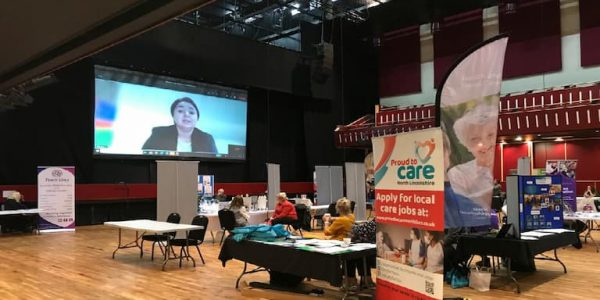 Large screen with pictur eof Holly Mumby Croft at Baths Hall Jobs Expo