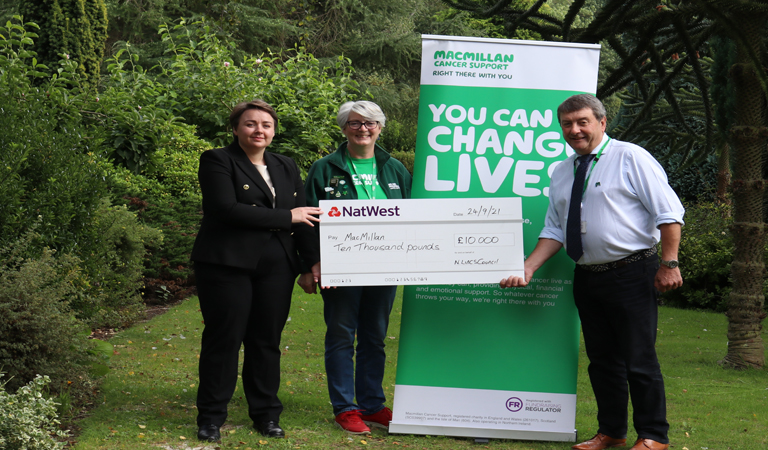Photograph of MP for Scunthorpe, Holly Mumby-Croft presenting a cheque to Macmillan Cancer Research