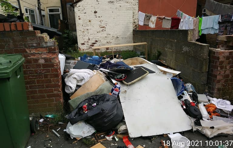 Landlord fined over rubbish-filled garden